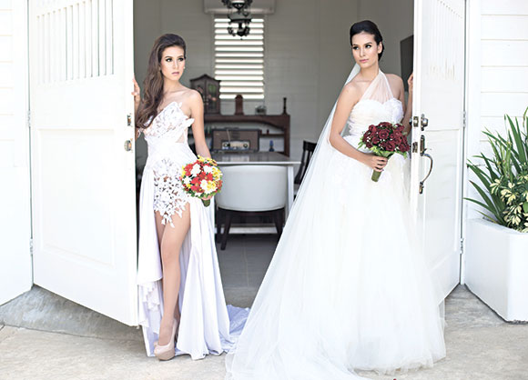 ALL SET. The bride and the maid-of-honor all set to walk down the aisle. Gowns by Hanz Coquilla.