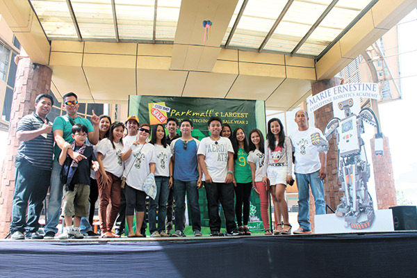 ROBOT ENTHUSIASTS. Cebu Robotics Society founders Donald Dungog and Jonathan Cartillo along with their members and Marie Ernestine teachers.