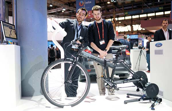 EASY RIDER. This e-bike from Ford on display at the Mobile World Congress, the world's largest mobile phone trade show, in Barcelona, Spain can be connected to a Bluetooth heart-rate monitor to optimize any workout, and is also programmed to let you cool down during the final stretch of your exercise session. (AP FOTO)