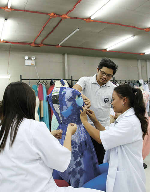 MEZZANINE MOMENTS. Ronald Villavelez, along with his skilled seamstresses, applies finishing touches on one of his creations at the mezzanine of Ronald Enrico Atelier.