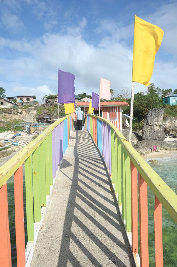 LET'S GO. Footbridge connecting the Gibitngil Funtastic Island to the mainland in Medellin, Cebu. (SUN.STAR FILE)