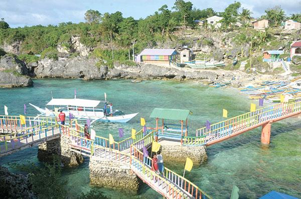 FUNTASTIC ISLAND. Gibitngil Island in Medellin, Cebu offers colorful fun under the sun. (Sun.Star file)