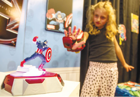 "ROLE PLAYING. Actress Evangeline Lindes role demonstrates a Playmation ""repulsor"" a wearable forearm attachment that puts kids in the role of Marvel superhero Iron Man, that connects via sensors with a base station called a ""power activator."" (AP FOTO)"