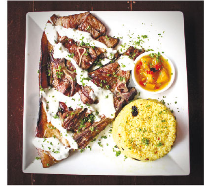 A Pan-seared Pork Chop was drizzled with Garlic Cilantro Yoghurt and paired with Garlic-Raisin Fried Rice and a side of Mango Chutney in their Dragon Chops.