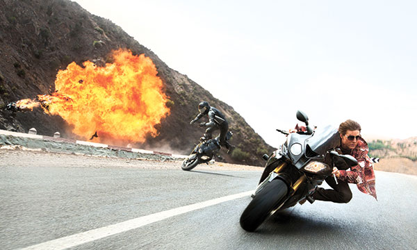 """Tom Cruise appears in a scene from """"Mission: Impossible — Rogue Nation."""" (AP FOTO)"""