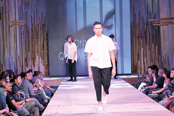 "CLEAN CUT. A model dons one of the designs of Yvonne Quisumbing, the lone female designer featured in Mensweek 2015. ""The fabrics are cottons to suit our weather. The cuts are simple and straightforward. The details, which are the clean slits, unite the whole collection,"" said Quisumbing of her designs."