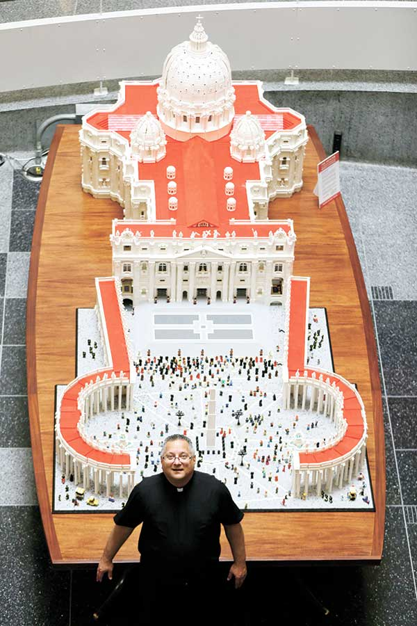 HOLY LEGO. The Rev. Bob Simon (above) with his Lego representation of the St. Peter's basilica and square, which is made up of half a million Lego pieces, at The Franklin Institute in Philadelphia. (AP PHOTO)