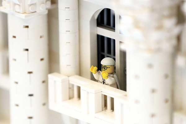A Lego pope figure on a balcony overlooking the crowd in the piazza. (AP PHOTO)