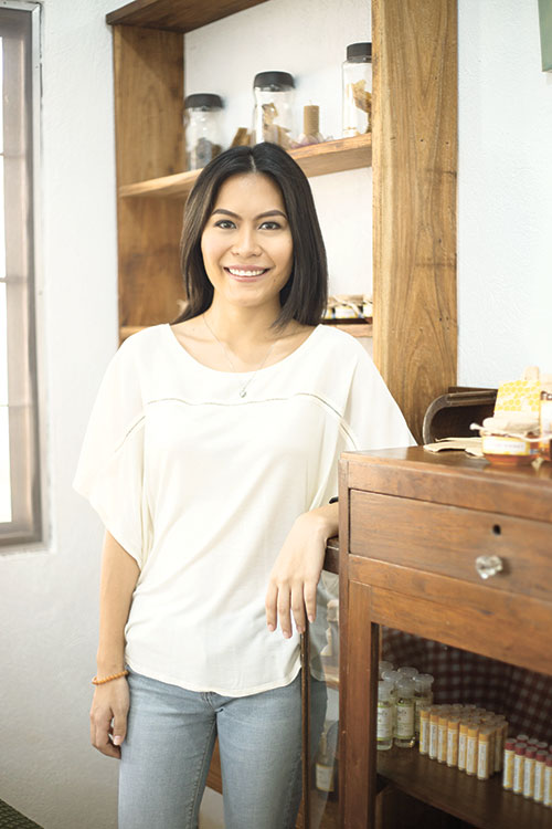 """BUSY BEE. Isan de Jesus handles marketing and sales of real organic honey from the family business called Dad's Organic Farm. Her official designation? She's """"The Farmer's Daughter,"""" of course."""
