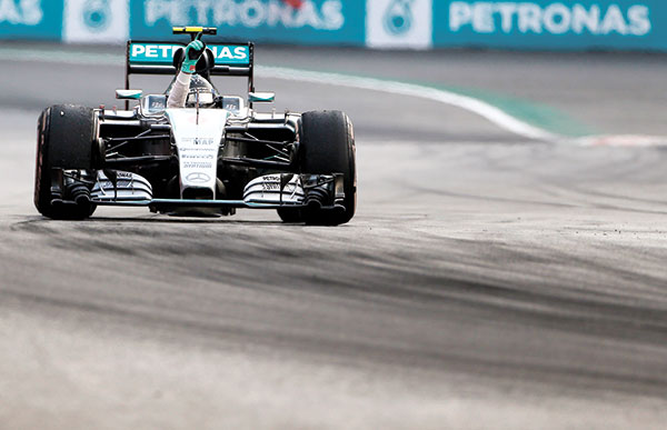 F1 IN MEXICO. Mercedes driver Nico Rosberg, from Germany, celebrates as he crosses the finish line during the Formula One Mexico Grand Prix auto race at the Hermanos Rodriguez racetrack in Mexico City. Nico Rosberg won the first Mexican Grand Prix since 1992 on Sunday, Nov. 1, for his fourth victory this season, denying Mercedes teammate Lewis Hamilton in his bid to tie the Formula One record of 13 victories in a season. Hamilton came second. (AP PHOTO)