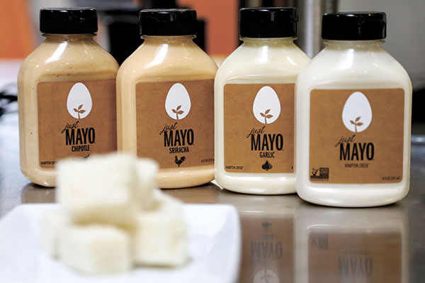"SIMPLE RULE. Hampton Creek Foods bottles of Just Mayo flavors at their office in San Francisco. Hampton Creek's mission is to replace the eggs in products without anyone noticing. In trying to appeal to the mainstream, co-founder and CEO Josh Tetrick has a simple rule. ""Number one, never use the word 'vegan,'"" he said. (AP PHOTO)"