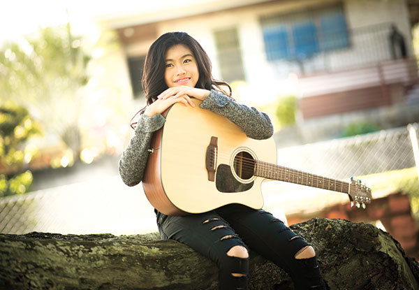 SONGWRITER. Young Ashley Go plays the guitar and ukulele, and writes songs about what people around her are going through.