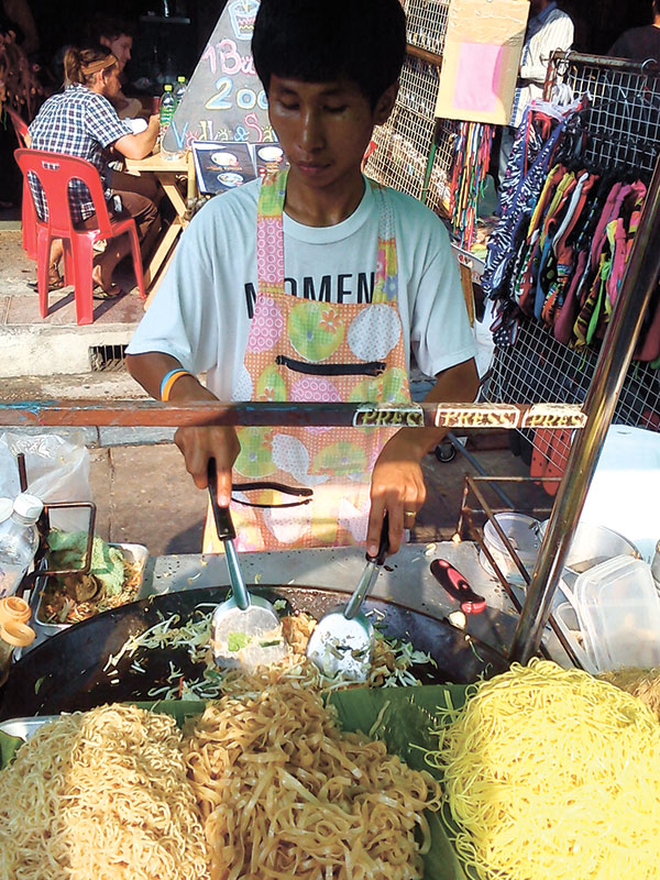 PAD THAI, ANYONE? A street vendor cooks ups some really good Pad Thai on Khaosan Road in Bangkok.