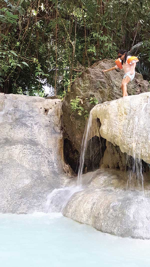 To-jump-or-not-to-jump-in-one-of-Aguinid-Fall's-natural-rock-formations-and-pools