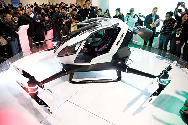 ONE BIG DRONE. People crowd around the EHang 184 autonomous aerial vehicle at the EHang booth at CES International gadget show in Las Vegas. The drone is large enough to fit a human passenger. (AP PHOTO)