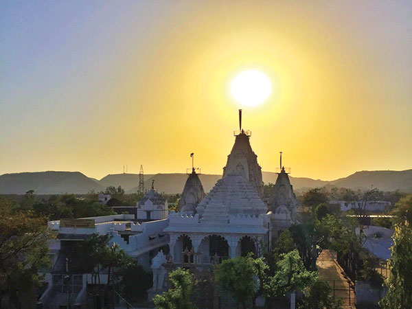 Sunset at the rooftop! View of the magnificent sunset and the Jainism Temple.