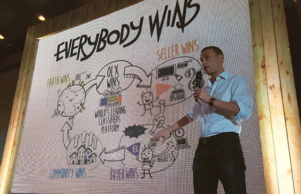 "OLX CYCLE. OLX Philippines General Manager Giancarlo Bonsel explains how OLX's ""virtuous cycle"" creates a community where ""everybody wins.""  (NSV PHOTO)"