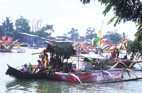 The colorful boats of some of the ancestral tribes during the Subang Sinugdanan line up as they prepare to disembark their vessel and join the others in Panagtagbo.