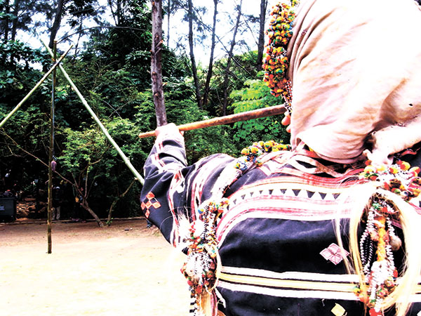 A lumad from the Bagobo-Tagabawa tribe plays the salopot, where he blows a dart to target using a long, hollow stick. This was during the Dula Kadayawan at People's Park.