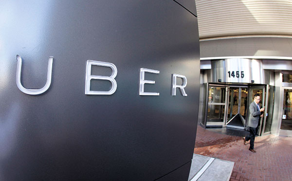 SAVINGS. Ubers new app design and features are aimed at saving passengers time and money. (AP PHOTO)